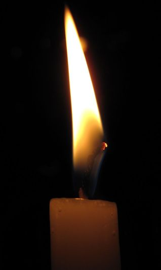 800px-A_Candle_in_the_Dark