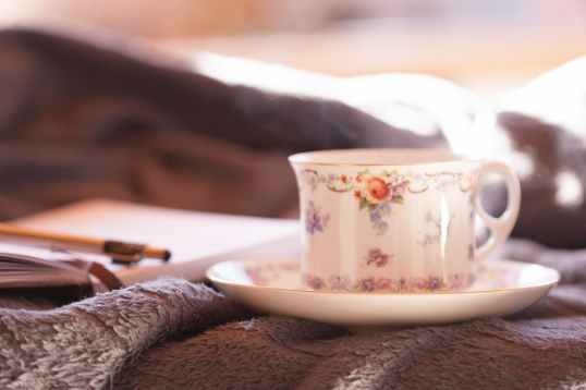close up photo of teacup and saucer